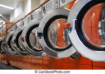 Row of washing machines in laundromat
