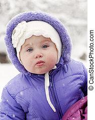 little girl in winte - beautiful little girl in a lilac suit...