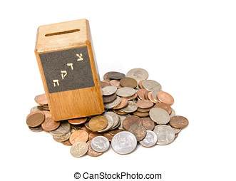 Wood tzedakah box on an assortment of coins - A small wooden...