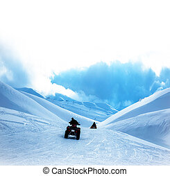 ATV in snowy mountains