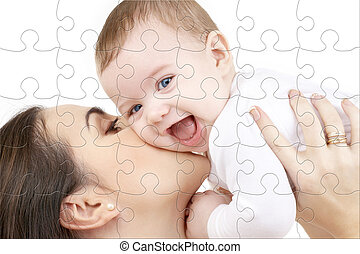 laughing baby playing with mother puzzle