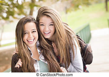 Mixed Race Women Pose for a Portrait Outside - Two...