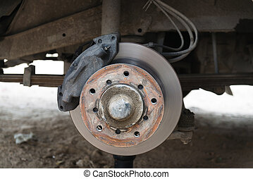 Front disk brake on a old car in process of damaged tyre...