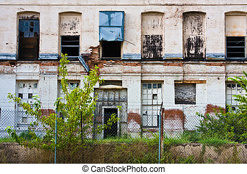 Wall Of Urban Decay - Badly neglected building facade at a...
