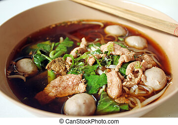 beef noodle soup - bowl of thai style beef noodle soup