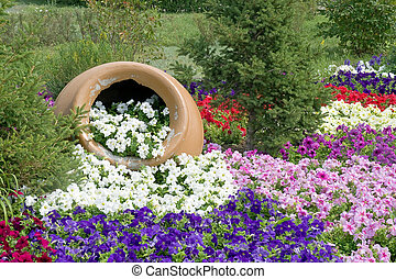 Flowerbed - Enormous clay pot with flowers on a flowerbed