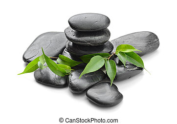 Zen stones - zen basalt stones and leaves on the white