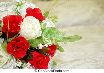 wedding day - bridal bouquet of flowers on the bed