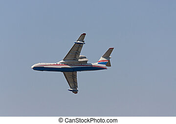 airplane - Airplane close-up on background of blue sky,...