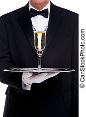 Butler serving a glass of champagne - A butler serving a...