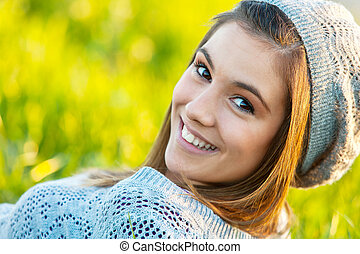 Cute girl wearing beanie outdoors. - Close up portrait of...