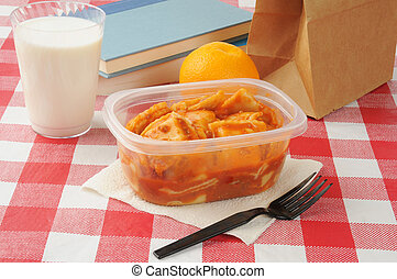 Sack lunch - Ravioli in a school sack lunch with a glass of...
