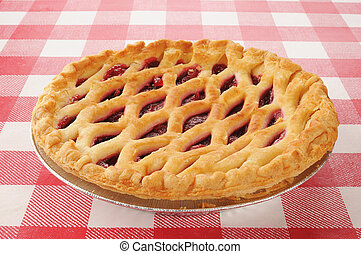 cherry pie with lattice top - A whole cherry pie on a...