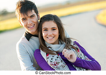 Portrait of handsome young couple in countryside.