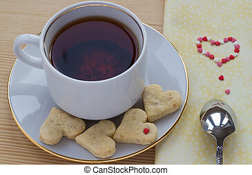 Cup of rooibos tea with heart shaped cookies for Valentine's day