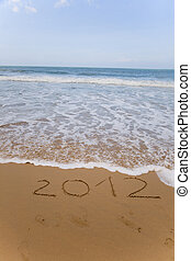 new 2012 year numbers drawings in the sand on the beach