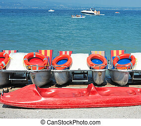 Catamarans in Sirmione - Colorful cotamarans on a beach of...