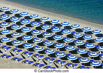 Scilla beach umbrellas from above - View on a beach with...