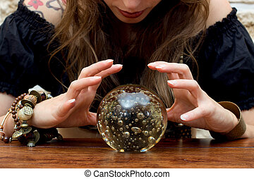 beautiful woman looks to the future - Young fortune teller...