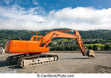 Excavator at construction site - Excavator with metal tracks...