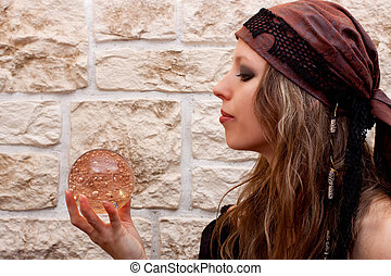 Side view of a female fortune teller - Side view of a pretty...
