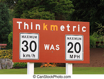 Think Metric - Thinkmetric sign at a US / Canada border...