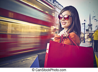 Woman after shopping next to train