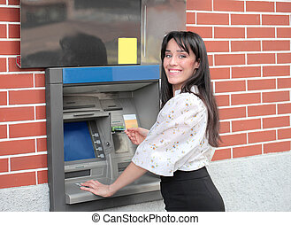 Woman with credit card - Brunette woman with credit card