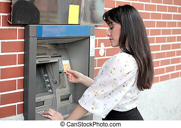 Woman at ATM - Brunette woman at ATM