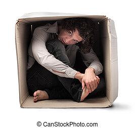 Man hiding in box