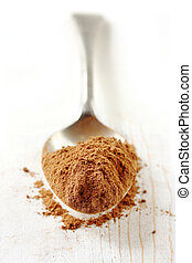 Spoonful of Cocoa Powder - Cocoa powder on an old silver...