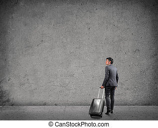 businessman with luggage - businessman walking with luggage...