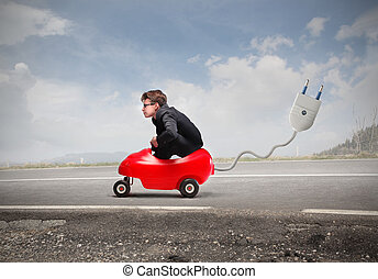 Little boy in car with plug - Little businessboy in car with...