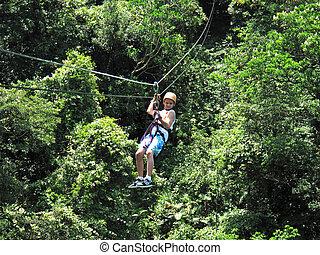 Boy on zipline in Costa Rica - Boy is ziplining in Costa...