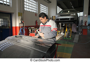Mechanician repairing car at work