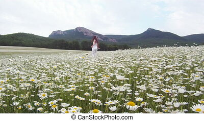 Surrounded by flowers - Woman in a field surrounded by...
