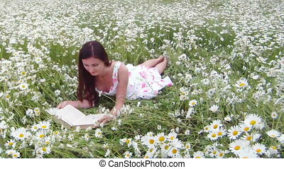 Summer time - Reading outdoors among the daisies