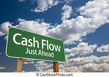 Cash Flow Green Road Sign Over Dramatic Clouds and Sky.
