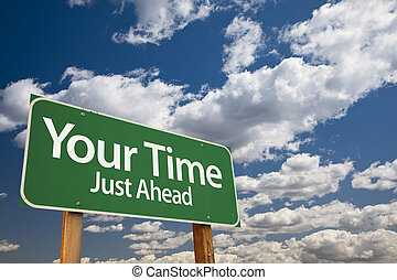 Your Time Green Road Sign Over Dramatic Clouds and Sky