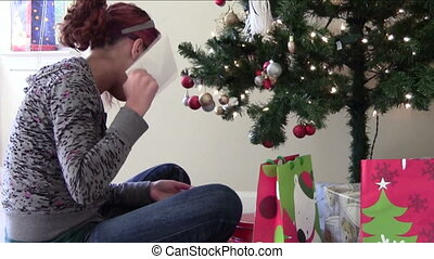 Christmas Anticipation - Teen asking to open gift