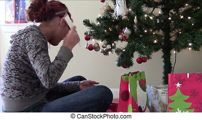 Christmas Anticipation - Teen asking permission to open gift