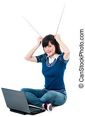 Young Woman With Laptop And Holding Antennas On Head