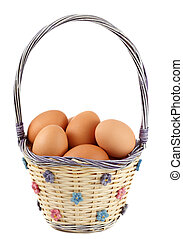 brown eggs - fresh whole brown eggs on wicker basket, white...