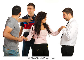 Woman between three guys - Woman flirting with one man while...