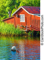 Boathouse during summer - Idyllic boathouse during summer in...