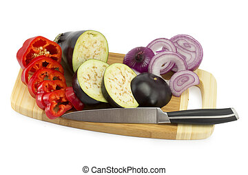 cut vegetables on the board - cut onion, papper, eggplant,...
