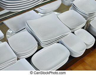 plates - a lot of white plates in a shop