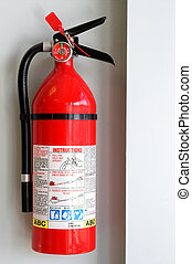 Fire Extiguisher - A fire extigusher mounted to the wall.