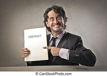 businessman contract - businessman sitting at the table...