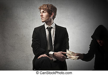 Man bribing businessman - Man bribing young businessman